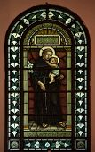 CETINJE, MONTENEGRO - JUNE 09, 2012: Saint Anthony of Padua, Stained glass in Catholic Church of St.