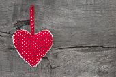 Top View Of Red Dotted Heart Decoration On Wooden Background - Country Style