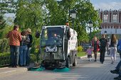 MOSCOW, RUSSIA - MAY 17, 2014: Street sweeper in the Alexander garden. About 6,000 vacuum street cle