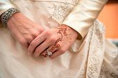 Beautiful female hands with mehndi decoration