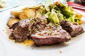 juicy steak beef meat and potatoes