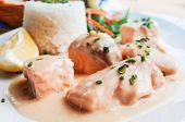 salmon and rice-french cuisine dish with tomato and salmon