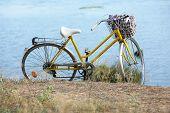 Bicycle near lake during sunset