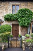 WILTSHIRE, CHIPPENHAM, UK - AUGUST 9, 2014: Castle Combe, unique old English village with luxury hot
