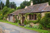 CHIPPENHAM, UK - AUGUST 9, 2014: Castle Combe village. Old house