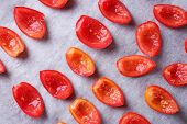 Tomatoes on drying tray, close-up