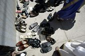 NEW YORK - AUGUST 30: Hindus leave their shoes outside the Sri Ganesa Chaturthi prior to praying in