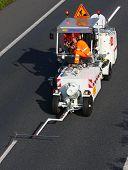 PILSEN CZECH REPUBLIC - AUGUST 19, 2014: Unidentified workers driving maintenance vehicle. Painting