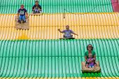 People On Carnival Slide At State Fair