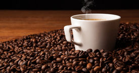 foto of peppy  - cup of black coffee and roasted coffe beans close up - JPG