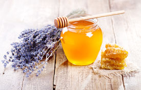 pic of honeycomb  - jar of honey with honeycomb and lavander flowers on wooden table - JPG