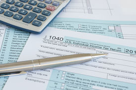 image of irs  - Filling in US income tax return IRS 1040 forms - JPG