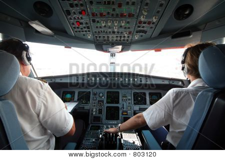 Picture or Photo of Jet airplane cockpit with two pilots crewmembers