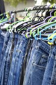 Jeans Hanging On A Rack.
