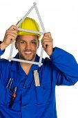 a worker in an industrial enterprise (craftsmen) with helmet wants to build a house.