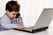 little boy on a laptop, symbol of the internet, e-commerce, consumer behavior