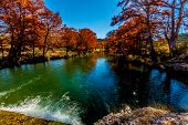 Beautiful Fiery Fall Foliage On The Guadalupe River, Texas.