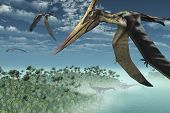 stock photo of pteranodon  - Three Pteranodon Longicepts fly over a misty prehistoric seascape with two diplodocus dinosaurs near the shore  - JPG