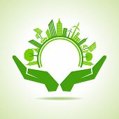 Ecology Concept - eco cityscape with hands