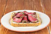 Bread toast with roastbeef on plate