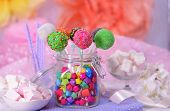 picture of cake pop  - Sweet cake pops in jar on table on bright background - JPG