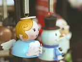 An Angel Christmas Ornament With Frosty And Santa