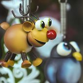 A Rudolph The Red Nosed Reindeer Ornament With A Penguin