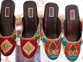 pic of shoes colorful  - Colorful ethnic shoes on flea market in New Delhi - JPG