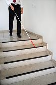 Blind Man Moving Down On Stairway