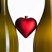 Empty Bottles Of Wine And Romantic Symbol