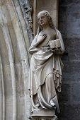 VIENNA, AUSTRIA - OCTOBER 11: Statue of Saint, facade of Minoriten kirche in Vienna, Austria on October 11, 2014.