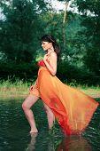 stock photo of undine  - Beautiful water fairy standing in the water - JPG