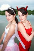 picture of spoiled brat  - Teenage girls dressed as devil and angel - JPG