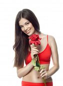 closeup portrait of attractive  caucasian smiling woman brunette isolated on white studio shot lips toothy smile face hair head and shoulders looking at camera tooth body red rose flower