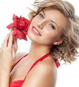 closeup portrait of attractive  caucasian smiling woman blond isolated on white studio shot lips toothy smile face hair head and shoulders looking at camera blue eyes tooth red rose flower
