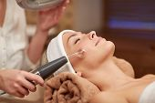 Постер, плакат: people beauty spa cosmetology and technology concept close up of beautiful young woman lying wi