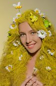 Woman With Yellow Hair, Flowers, And Bees In Them