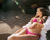 beauty young woman after spa in bikini and robe at hotel resort,