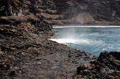 Wave Mist By Volcanic Shoreline