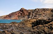 stock photo of off-shore  - The rugged volcanic coastline and shores of the island of Fogo Part of the archipelago of Cape Verde off the west coast of Africa - JPG