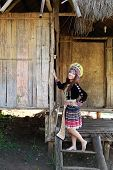 image of hmong  - Traditionally dressed Mhong hill tribe woman in the wooden cottage - JPG