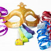 Carnival Mask With Colorful Streamers And Party Horns On White Background