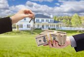 stock photo of yard sale  - Handing Over Cash For House Keys in Front of Beautiful New Home - JPG