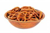 picture of pretzels  - A wooden bowl of salted pretzels on a white background - JPG