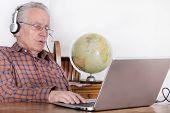 foto of older men  - Older man using laptop for internet communication - JPG