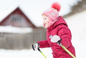 child engaged on  skiing in the winter