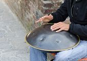 Man Play Instrument Made Of Metal And Called Hang