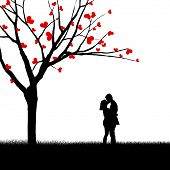foto of beside  - Silhouette of a couple kissing beside a love tree - JPG