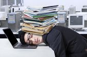 Frustrated Man With Document Sleeping In Office