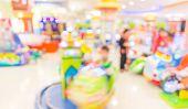 Arcade Game Machine Shop Blur Background With Bokeh Image.